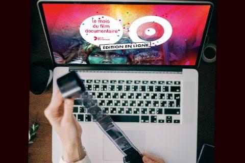 photo représentant un écran d'ordinateur allumé avec le visuel du mois du film documentaire.