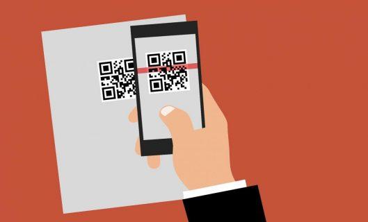 Dessin d'une main qui vient lire avec un smartphone un QR code
